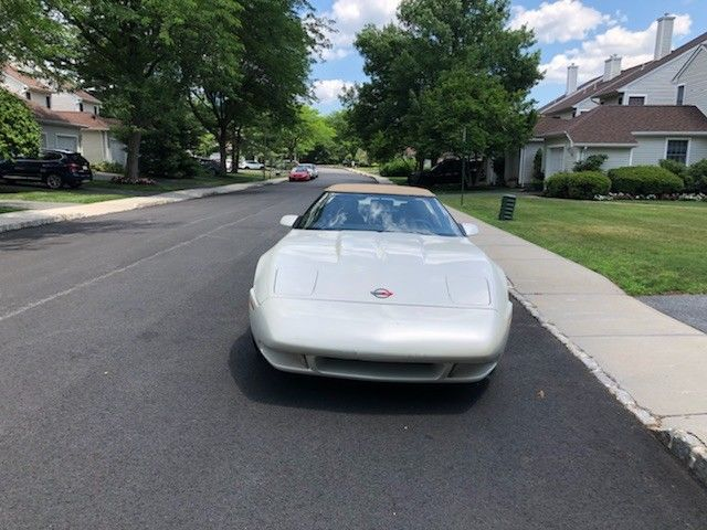 1989 Chevrolet Corvette convertible with a Kaminari body kit
